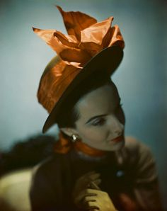 1946  photo by Constantin Joffe    Model is wearing Lilly Daché's toast-colored bare-browed sailor hat with a tangerine bow.