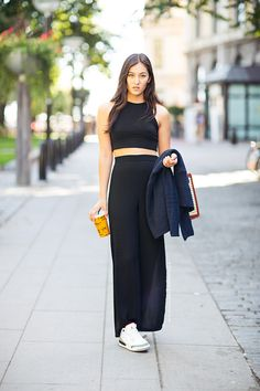 Shop this look on Lookastic:  http://lookastic.com/women/looks/black-cropped-top-and-black-maxi-skirt-and-white-low-top-sneakers-and-navy-shawl-cardigan/2289  — Black Cropped Top  — Black Maxi Skirt  — White Low Top Sneakers  — Navy Shawl Cardigan