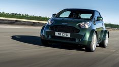 Earlier this decade, Aston Martin rebadged a Scion iQ and sold the car complete with a wheezy engine as the Cygnet. It was a cost-effective way for Aston Martin to get its average emissions … Aston Martin Db3, Martin S, Console Centrale, Toyota, Goodwood Festival Of Speed, City Car, Smart Car, Running Gear, Fuel Economy