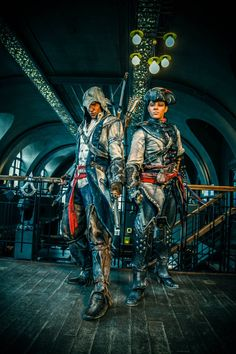 """Assassin's Creed Cosplay. Rather than try to make it look as """"real"""" as possible, these two detailed their costumes and applied makeup to emulate the in-game textures. So cool. :o"""
