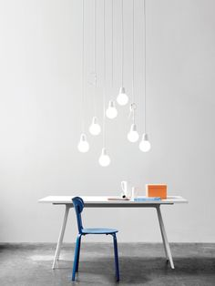 Bulb Fiction consists of a hand-blown acid treated opal glass shade and an aluminium suspension with a soft, organic shape. The fixture creates the illusion of a classic incandescent bulb, hiding the low energy light source and ensures a comfortable, soft light. Used alone or in clusters, Bulb Fiction makes it possible to play with the design by tying knots in the cord or by gathering several lamps together to form a modern chandelier.