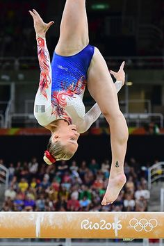 France's Marine Brevet competes in the qualifying for the women's Beam event of the Artistic Gymnastics at the Olympic Arena during the…