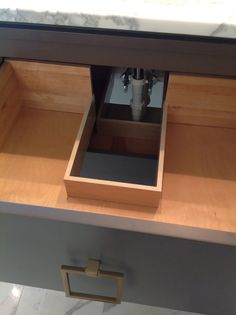 ...most plumbing is hidden by cabinet doors in the bath...why not add a drawer instead?