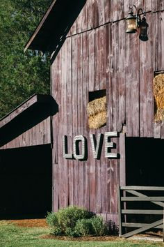 Love sign on outside of rustic barn for wedding.