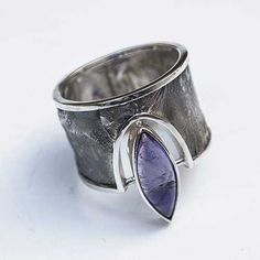 Silver ring made of technique flamowania. A wide ring adorned with amethyst…