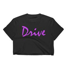A fitted crop top to pair with skirts, jeans, and much more. Made of 100% cotton and totally recyclable, this crop top has a soft feel and light texture. Made in the States for a lower carbon footprint and ethical working conditions - no sweathsops! #Drive #RyanGosling #Fan #Merch #GraphicPrint #Tribute #Novelty