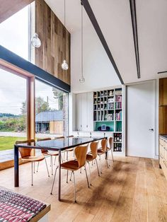 Double-height dining space with engineered floorboards