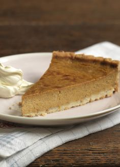 Cosy spiced pumpkin pie is a must-have in the autumn with softly whipped cream.