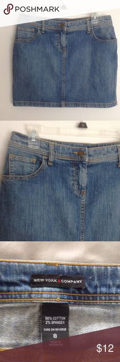 Denim Mini Skirt Denim mini skirt with zipper front and pickets on the back from !New York & Company. New York & Company Skirts Mini