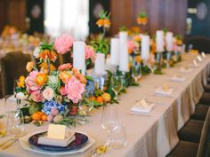 Add color to your reception table with your floral vessels. Mini ginger jars are the perfect base for a vibrant arrangement of roses, ranunculus and peonies. l TheKnot.com