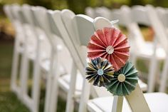 Paper pinwheels on the chairs - so cute and subtle.