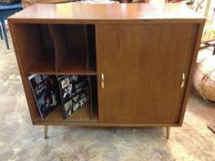 Vintage 1950's Record Cabinet     Sliding Doors     Multiple slots to hold your record collection.     $225    Read more: http://dallas.ebayclassifieds.com/furniture/dallas/vintage-1950-s-record-cabinet/?ad=24403965#ixzz2BUc3Ko9q