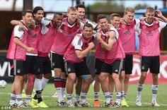 Sun's out, guns out: Podolski and Julian Draxler show off their muscles during a relaxed s...