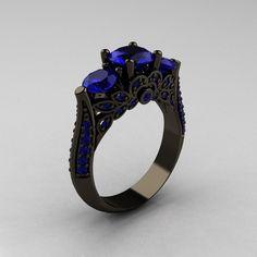 anillo de compromiso negro piedra azul
