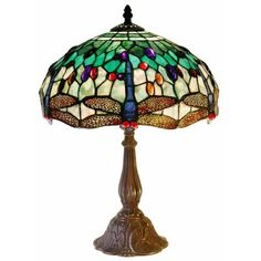 Add a vintage feel to your home decor with this cut-glass table lamp. This Tiffany-style lamp features beautiful white dragonflies and a lovely array of colors. This elegant lamp has a detailed base with a stylish neutral finish to match your decor. Metal Table Lamps, White Table Lamp, Glass Table, Glass Desk, Tiffany White, Dragonfly Stained Glass, Tiffany Style Table Lamps, Lamp Shade Store, Chandeliers