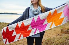 Create a beautiful decoration that looks good year-round with this Modern Maple Leaf Table Runner. Use the half square triangle pattern technique to create the leaves for this simple yet tasteful piece of home decor or a full-sized quilt.
