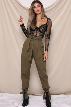 To all the baddies, trust us, these pants are worth it. Meet our RUNAWAY THE LABEL WORK IT PANTS. Available in khaki, these cargo pants feature tie-up details around the waist and ankles, belt loops, pockets and a zipper at the front.   Model is wearing a size Small. Runaway The Label, Ankle Pants, Running Away, Cargo Pants, Baddies, Online Boutiques, Trust, Street Wear, Jumpsuit