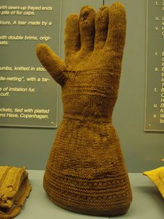 Knitted wool glove, 16th/17th c excavated in Copenhagen. Note the simple lace (k2tog, yo) on the cuff and the pattern on the gauntlet (k 1st row, k2 p2 2nd row). Danish National Museum.
