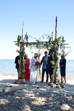 Driftwood chuppah covered in flowers