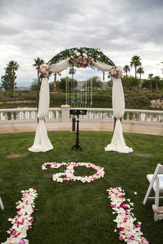 Las Vegas Wedding Planner, Siena Golf Club, draped arch, crystal drops, lakeside ceremony, floral letter, bridal party, statement necklace, birdhouse favor, cake pop favor, kissing bell, cherry blossom stationery, silver chiavari chairs, square wedding cake, cathedral veil, first dance