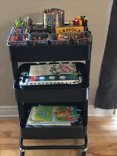 IKEA Raskog cart - Homework / craft zone for the kids. All their crayons, pencils, scissors on the top shelf and each kid has a shelf for their workbooks and drawings. Keeps my table clear!