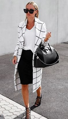 This monochrome look is very chic although I would wear a plain pair of black heels instead which would make the outfit classy. The coat is lovely.