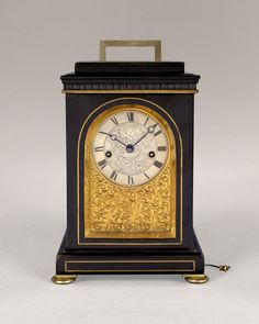 JAMES SCOTT King Sq., A rare English ebonised and brass inlaid mantel clock.c.1835.