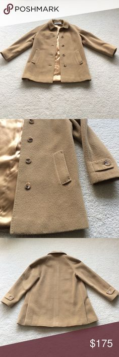 Vintage I. Magnin 1960's camel hair wool overcoat Vintage I. Magnin 1960's camel hair wool overcoat.  In perfect condition.  This classic style is back on trend.  Beautiful stitching detail.  Satin lining.  Drops to upper thigh.  Fits US women sizes 4 and 6. I. Magnin Jackets & Coats