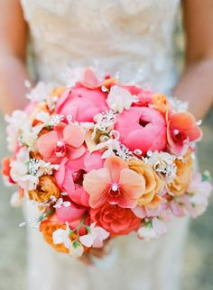 Pink/Coral/Orange Wedding Bouquet Arranged With: Peonies, Roses, Ranunculus, Phalaenopsis Orchids, Sweet Peas Bridal Flowers, Beautiful Flowers, Beautiful Bouquets, Wax Flowers, Beautiful Sunset, Fall Wedding, Dream Wedding, Wedding Blog, Orange Wedding