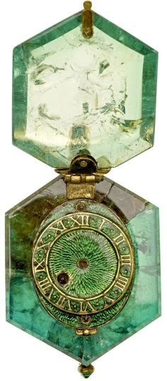 Set in a single Colombian emerald crystal, this astonishing watch dating back four centuries is going on display for the first time as part of one of the world's largest Elizabethan jewelry collections. The Cheapside Hoard, a dazzling haul of almost 500 pieces from the Elizabethan and early Stuart eras, was uncovered by a group of labourers under a cellar floor in London's Cheapside in 1912.