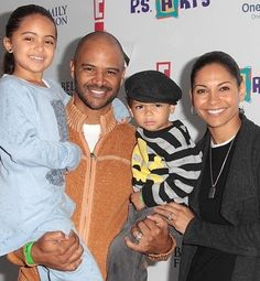 actress Salli Richardson-Whitfield, her husband, actor Dondre Whitfield, and their two children Parker and Dre.