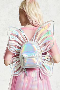 """Adorable// """"A structured faux patent leather backpack featuring a holographic finish with a butterfly wings design, two zipper compartments, an interior zipper pocket, two interior slip pockets, and adjustable buckled shoulder straps"""" Cute Mini Backpacks, Fantasias Halloween, Wings Design, Star Butterfly, Butterfly Fairy, Luna Lovegood, Star Vs The Forces Of Evil, Girls Bags, Cute Bags"""