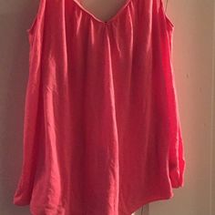 American Eagle spaghetti strap coral top Sz M Very bright coral top, great for the summer! It flows down beautifully. Very soft and comfy. Build in bra. Sz M Can also fit a Small.  American Eagle Outfitters Tops