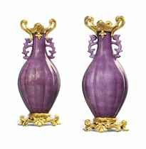 A RARE PAIR OF LATE LOUIS XV ORMOLU-MOUNTED CHINESE PORCELAIN LOBED AUBERGINE-GLAZED TWIN-HANDLE VASES THE MOUNTS ATTRIBUTED TO JEAN-CLAUDE CHAMBELLAN DUPLESSIS, CIRCA 1765, THE PORCELAIN 18TH CENTURY