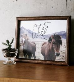 "The loopy handwriting atop this photo of wild horses reminds us all to, ""Keep it wild."" The artist captured this image on a trip to Iceland and decided there was no better message to pair with it than one of staying wild and unruly."