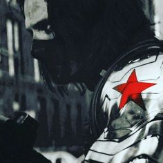 Bucky This is coool,the whole picture is black and white,only that star burns red on his robotic arm.