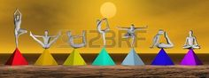 Yoga postures on seven colorful prymids for chakras by brown sunset