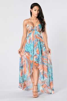 - Available in Blue - V Neckline - Hi-Low Hemline - Midi Length - Floral Print - Woven - Cutout Waist - Lined - 100% Polyester