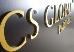 Sign makers in London: CS GLOBAL PARTNERS Reception sign board