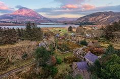 Nestled in the shadow of Mount Errigal, in Ireland's County Donegal, sits the ruined ghost village of Glentornan, with its cluster of abandoned cottages.