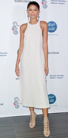 Zendaya graced the Nordstrom Del Amo Fashion Center Opening Gala in a breezy white sleeveless Elizabeth and James number, complete with chandelier earrings and Schutz cage booties.