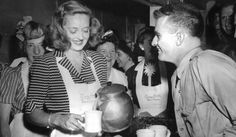 Bette Davis, Founder Of The Hollywood Canteen, Pours Coffee At The Stage Door Canteen In New York.