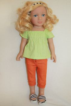 My Salon Doll: The ONLY doll with REAL HAIR!  This ensemble is so unique; light green blouse, bright orange capris, and zebra striped sandals and headband.  Together, they create a one-of-a-kind fashion statement!