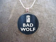 Doctor Who - BAD WOLF - The Bad Wolf message was scattered across time and space, to lead Rose Tyler to save the Doctor - and as we find out later, she makes Captain Jack Harkness eternal ... Thank goodness, because hes a cutie.  Your eye-catching glass pendant starts as a crystal clear domed glass cabochon. The high-definition laser printed digital image is securely bonded to the reverse side of the glass using a multistage process, rendering a 3-dimensional effect. Pendants are sealed…