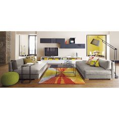 They have two of these piazza velvet storm sofas from CB2 like this in their living room. They're super comfy, and when they have family movie night they can push them together to make a big bed.