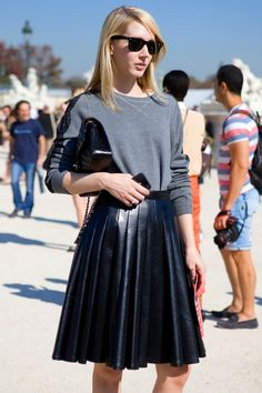 sweatshirt coupled with leather accordion skirt. check out more sweatshirts w/ skirts.
