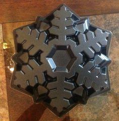 Nordic Ware Snowflake black cake pan/mold. A DIFFERENT one than I have already pinned.