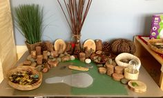 """From my classroom: Small World Play with green paper and felt, wood cuts, pebbles, and twigs. I placed two mirrors under the paper cutout to make a """"pond""""."""