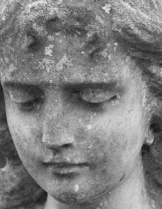 Close up of the little lady in grey. Charlestown cemetary, Cornwall.