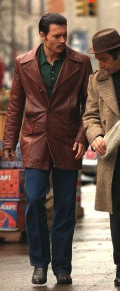 Johnny Depp as Joe Pistone, aka Donnie Brasco, with his clothing undergoing Al Pacino's scrutiny in Donnie Brasco.